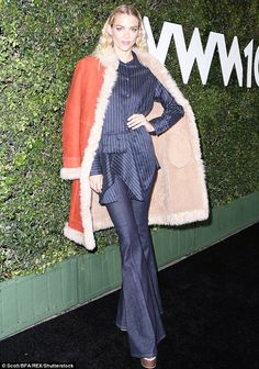 Upping the style stakes: Jaime King rocked a retro look in falres and a silk jacket shirt which she teamed with a shearling leather jacket