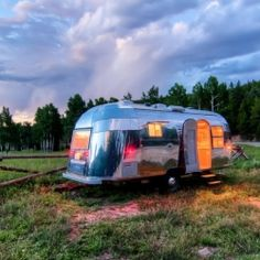 Vintage travel trailer restored with modern technology and design elements.