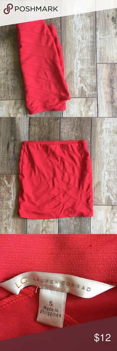 Lauren Conrad Red Mini Skirt Lauren Conrad brand size small red Mini Skirt. Waist is 25 inches length is 16.5 inches. 76% polyester 20% rayon 4% spandex. In excellent condition. LC Lauren Conrad Skirts Mini