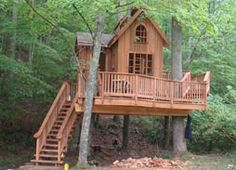 Near Atlanta, Georgia Spring 2007 This treehouse was built for neighbors in a residential community. It has as a main room, a look out tower, and a crows nest that is accessed by a swinging bridge. Photographed as it was nearing completion, it will soon be enjoyed by children and adults alike.