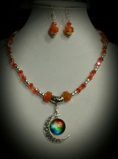 Crescent Moon Charm with silver and orange glass crystal beads necklace and earrings set.