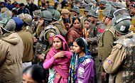Police officials walking alongside women protesters during a rallyin Delhi, calling for better safety of women, on Dec. 30.