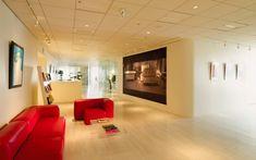 We are a global and creative design studio in Geneva, Tokyo and Beijing. Showroom Interior Design, Retail Interior, Space Photography, Framing Photography, Retail Experience, Red Sofa, Retail Space, Wood Floor, Retail Design