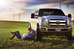 Cute couple with Ford Truck.