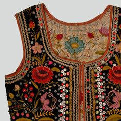 Woman's bodice of black velvet. Decorated with haberdashery trimmings, buttons, sequins and embroidery. Trimmed with red tape. Fastened with hooks and eyes. Hand and machine-sewn.    Western Krakowiak Folk, Giebułtów, P. Kraków, 1920s-1930s