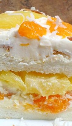 Ambrosia Cake---- Very light, very tropical. Ate a fourth of this cake and still went for a 20 minute jog with my mother 15 minutes later. The pineapple and oranges take me back to the Kona Days. : )