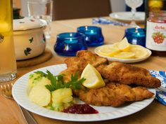 The national dish of Austria is Wiener schnitzel (Veal escalope coated in flour, egg and breadcrumbs). Serve with a warm potato salad and cranberry sauce.