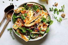Halloumi salad with lightly spiced, roasted butternut squash & quinoa. Served with a lemon and honey dressing, this is a lovely satisfying lunch.