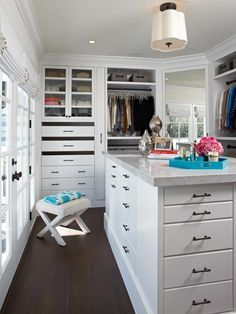 TV personality Giuliana Rancic gives us a peek inside her jaw-dropping walk-in closet designed by Lisa Adams.