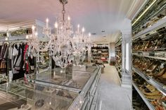 Vanessa N.: Closet  Gorgeous chandelier hangs over island with glass top showcasing accessories!