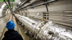 A maintenance worker inspects the Large Hadron Collider tunnel in the CERN research center on November 19, 2013 in Geneva, Switzerland.