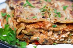 Hearty, cheesy, meaty & comforting Vegan Lasagna. This lasagna is perfectly layered with a thick & meaty tomato sauce + a cheesy, ricotta-style cheese sauce.