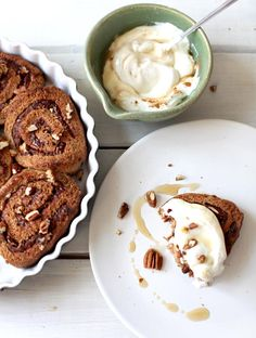"Mmm can't you just smell homemade Cinnamon buns cooking? Made with whole spelt flour, applesauce, and dates, this is one Sunday breakfast treat that also makes a delicious mid-week snack with tea.  It is cinnamon-y, rich tasting, and not overly sweet. In fact the ""frosting"" for the cinnamon buns is made with yogurt. #EatThisNotThat"