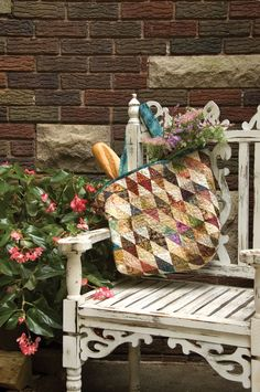 """""""Tote Bag"""" from Friendship Triangles by Edyta Sitar for Laundry Basket Quilts. Let quilting designer Edyta Sitar show you how quilting triangles can turn your quilt scraps into handy quilting projects like this tote bag! Find it online: http://landauerpub.com/Friendship-Triangles.html"""