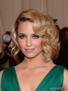 lose bun towards one side with hair stands down & curled