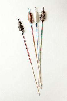 I remember Emily Henderson had similar arrows kept in a big jar! Thread Wrapped Arrow #anthropologie
