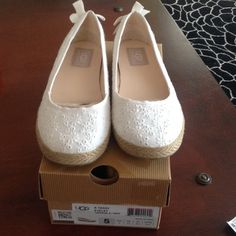 Ugg Flats Authentic UGG Tassy Eyelet Textile Flats Shoes. NEW with box. Still in stores. Size 5 big kids, but they run very big I am a 6.6/7 and they are perfect. UGG Shoes Flats & Loafers