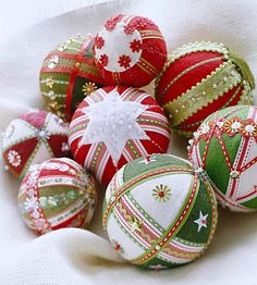 Felt, beads, ribbon, embroidery, sequins, lace. These ornaments are truly handmade and so pretty!