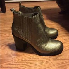 Gold Metallic Heeled Boots Worn once around the house (purchased used). Size 8-thought I could make it work but since I normally wear an 8.5-9 so they're too small with the socks I normally wear. Very comfortable with good arch support. Looks great with black skinny jeans and a cropped jacket. There is a white mark on the right heel-not sure how it got there. No trades and price is firm. Shoes Heeled Boots