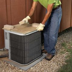 There's no reason to wrap your entire air conditioner for the winter, and many manufacturers advise against it because it can invite rodents and cause condensation, which can lead to early corrosion. But it's not a bad idea to set a piece of plywood on top of the unit to protect it from falling icicles. See Tip 5 to learn one way of preventing the icicles in the first place. And see our maintenance guide to learn how to clean your air conditioners in the spring.