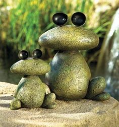 These stone frogs are just cute. I couldn't find the actual page, but I think you could easily do this yourself with some select stones that resembled these shapes, some really good glue, a bit of spray paint and a sealer.......D.
