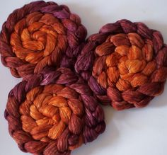 Roving for spinning  50/50 hand dyed silk merino gradient roving 2ozs Plum and Ginger. $13.25, via Etsy.