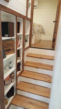 The stairs up to the bedroom have drawers and a built-in bookcase.