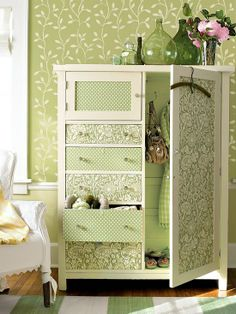 Wallpaper isn't just for walls! This bright and cheerful piece has been updated with papered drawer and door fronts.
