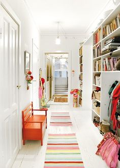 painted white floor plus colorful striped rugs
