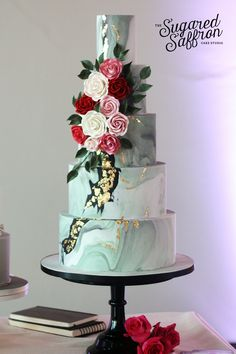 Dark marble cake with bouquet of sugar flowers. London wedding cakes by Sugared Saffron.