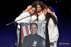 Genesis Villella (C), and twins Delilah and Peter Vega, children of New York City Police Department (NYPD) officer Miosotis Familia, participate during her funeral service, at the World Changers Church, in the Bronx borough of New York City, July 11, 2017.  REUTERS/Richard Drew/Pool #nypd #reuters #reutersphotos #funeral #police #nyc #newyork
