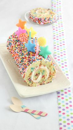 Roll up your 9x13 cake in a towel while still hot, then refrigerate. You'll have an easy and impressive birthday surprise in no time!