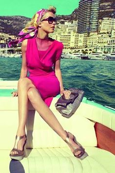 This looks PERFECT. Boating out in the sun..with a perfect chic pink dress. Wish I was doing that right now. le sigh..