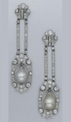 PLATINUM, PEARL AND DIAMOND EARRINGS, CIRCA 1910. Numerous diamonds and two pearls approx 2.70 cts.
