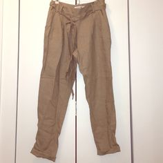 High waisted khaki linen pants High waisted khaki linen pants. Never worn. Cropped ankle. Very cute. Goes great with a fitted top tucked in and pointed pumps. Forever 21 Pants