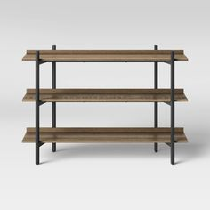 Add to your home decor while bringing easy organization to your entryway, living room or home office with the Taft 3-Shelf Console from Project 62?. This mixed-material console table features wood-laminate shelves on a black coated steel frame for a modern look that will complement a wide variety of decor schemes and color palettes. The open design makes it ideal for displaying objects like stacks of books or decorative sculptures, as well as for holding storage bins or baskets to help you keep Sofa Tables, Console Table, Decorative Storage Bins, Tv Storage, Piano Room, Stack Of Books, Wood Laminate, Wood Shelves, Entryway Tables