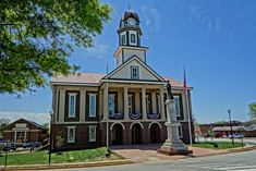"""The Historic County Chatham Co. Courthouse sits in the middle of a traditional roundabout (hence Pittsboro, NC's moniker """"The Circle City""""). Its clock tower has for decades provided a welcome site for students traveling north to UNC-Chapel Hill and travelers on their way south and east towards Pinehurst, Camp Lejeune and the NC coast."""