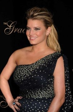 Jessica Simpson wears M.C.L by Matthew Campbell Laurenza blue topaz ring at Alliance for Women In Media's 2010 Gracies Awards in Beverly Hills, California, 2010
