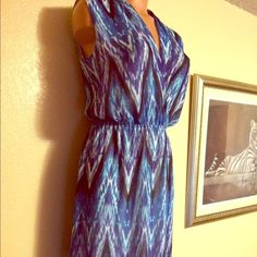 NWOT Bebe Maxi Dress New without tags. Long floor length maxi dress. Chiffon-like material. Size: small. Gorgeous blues, blacks and whites in a tie die like design. Retails for $149 bebe Dresses Maxi