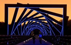 High Trestle Bridge: This former railroad bridge has been rehabilitated to stunning effect by David Dahlquist of RDG architects by ​​creating misaligned metal arches illuminated at night with a line of blue LED lighting.