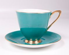 Vintage Royal Albert Footed Teacup Teal and Gold Bone China England Gaiety. $26.00, via Etsy.