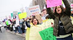 Like many of the women who rallied Saturday in Port Jefferson Station, Janine Truitt came because she's worried.The African-American mother of three fears the country,