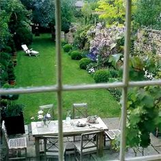 This pretty setting reminds me of my Aunt & Uncles garden from their upstairs window.