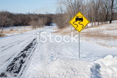 Sign indicating Dangerous Slippery Snow Covered Winter Road Royalty Free Stock Photo
