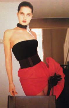 Pierre Cardin Haute Couture- A/W 1987-88 Staples mini dress with a black velvet bustier top and Taroni silk satin red skirt adorned with a large black flower. L'Officiel No. 734- September 1987