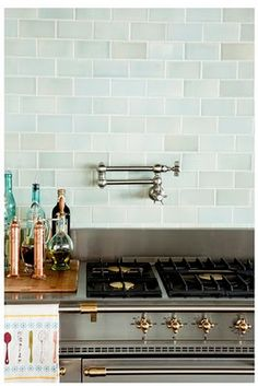 Faucet over the stove!!!!! So you don't have to lift heavy pots filled with water from the sink to the stove! I HAVE to have one! And the Seafoam subway tiles are pretty too