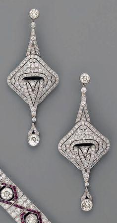 A pair of Art Deco platinum and diamond earrings, circa 1925. #ArtDeco #earrings