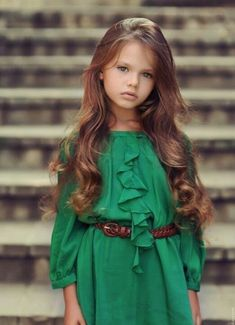 Cute little girls outfit! Long wavy hair blue eyes green dress brown belt kids designer coutre clothes Baby swag