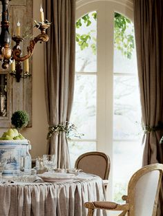 decked-out dining.... love the chairs & the olive branch rope on curtains