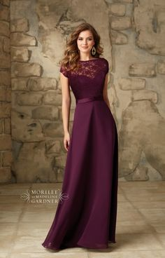 Mori Lee Bridesmaid 101 is a classy and modest style fit for any bridal party. This dress features a satin skirt and bodice with a removable lace bateau jacket that makes this style versatile and can be worn two different ways. The removable lace bateau jacket creates a high neck with cap sleeves and a low v-shaped back with a satin trim. Mori Lee Bridesmaid 101 is available in all sold lace colors.